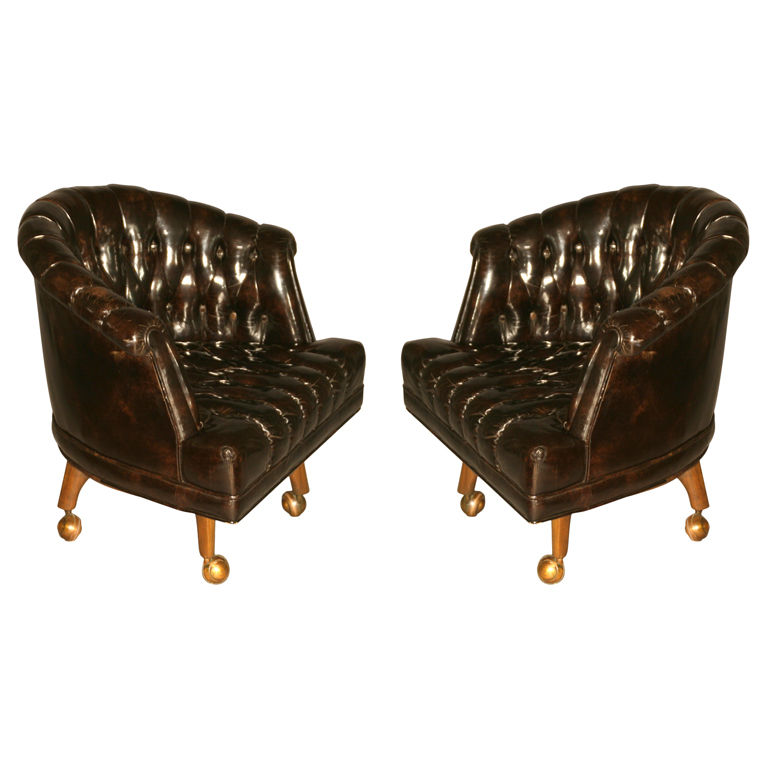 Leather Appears Black, Yet Bright Light Reveals A Very Dark Brown Color  With Some Deep Red. Heavy, Solidly Built Chair On A Mahogany Base That  Swivels.